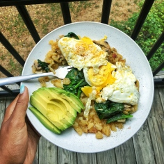 Sautéed potatoes, eggs, spinach, and avo